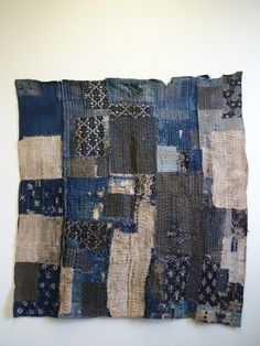 This boro, or ragged textile, from the mid 20th century is intensely sashiko stitched from many layers and was used as a cover for a heated table or kotatsu, which was the sole heating source in many old Japanese homes. Families would gather around the kotatsu and slip their legs under the kotatsugake for warmth.