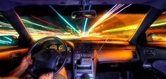 WHAT SLOW SHUTTER SPEED LOOKS LIKE: Using a slow shutter speed inside a moving car.