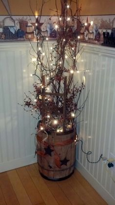 This is the best idea I have found for an old whiskey barrel! I have a bigger one but filling it with fake twigs and lights and sticking it in a corner of a dining room or living room! So cute!