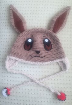 Crochet Pokemon Eevee hat! Crocheting with eyelash yarn is a nightmare, but…