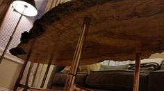 Live-edge Elm coffee table with copper pipe legs