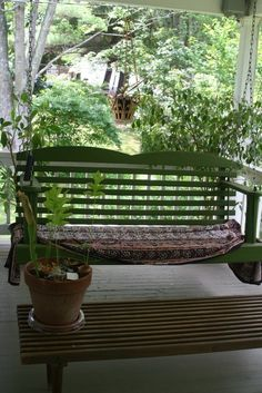porch swing for Josphine. blanket thrown over base