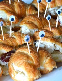 Chicken salad sandwiches on crescents decorated to look like crabs. pool party snack ideas