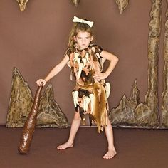 Cave Kid: With its simple cutout tunic and fun-to-sculpt teeth and bones, this prehistoric costume rocks for boys and girls.
