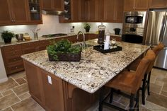Granite kitchen island granite kitchen island with seating granite kitchen island table Kitchen Marble, Kitchen Flooring, Wood Kitchen Cabinets, Kitchen Design Gallery, Brown Kitchen Cabinets, Kitchen Island Table, Granite Kitchen Counters, Wood Kitchen, Granite Countertops Kitchen