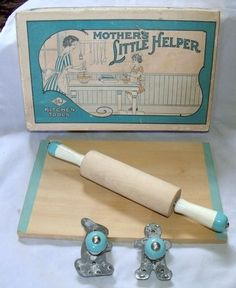 Vintage A Mother's Little Helper Toy Cookie Cutters Rolling Pin Bread Board - This is so cute!