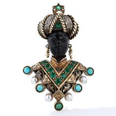 A regal Blackamoor brooch, hand-crafted in 18 karat yellow gold and silver by the eminent Venetian jeweler Nardi. Adorned in emeralds, turquoise and pearls, combined with hand-engraved details.