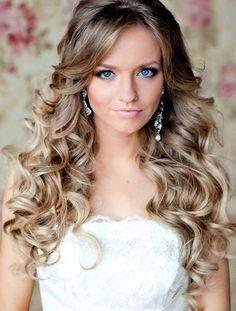 Bride's gorgeous down wedding hairstyle