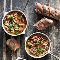 Mushroom, Sausage and Whole Grain Soup 1 pound  sweet Italian sausage, casings removed 2 tablespoons  white wine vinegar 1 1/4 cups  Bob's Red Mill whole grain medley 2 cups  diced sweet onion 1 pound  sliced wild mushrooms 2 ribs celery, sliced 3 cloves garlic, chopped 1 tablespoon  fresh chopped thyme 6 cups  unsalted chicken stock 3/4 teaspoon  salt 1/4 teaspoon  black pepper Fresh parsley, for garnish