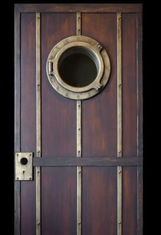 Beautiful door with porthole & metal trim by DaVinci Doors