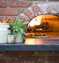 outdoor pizza oven by Sandy Koepke Interior & Garden Design