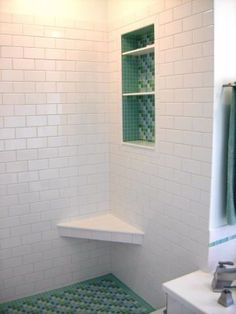 bijou blue and green mosaic tile bathroom shower floor and accents with custom recessed shelf