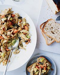 This healthy chicken salad features dried fruit, nuts, vegetables, and a tangy, curry-spiced yogurt instead of the usual mayo.