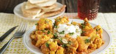 Indian cuisine really lets vegetables shine, and this dish is no exception. Hearty cauliflower and sweet butternut squash are steeped in a sauce redolent with garlic, ginger and earthy spices.