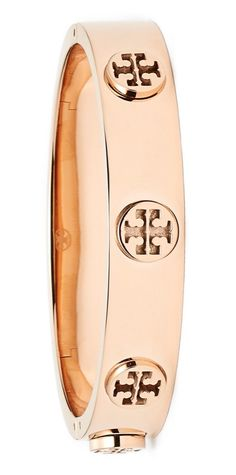 Signature Tory Burch T's stand out along this slender rose gold bracelet that can be worn alone or stacked with other bracelets for a modern look.