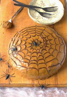 Treacle Spice Cake topped with Speculoos spread and a chocolate cobweb. Perfect for Halloween!