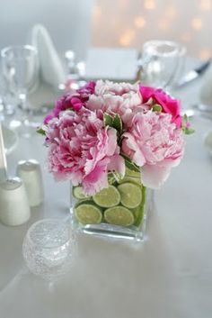 Perfect flowers for the the pink and green wedding reception tablescape that I just pinned! Fluffy pink peonies in square glass vases, finished by filling the water with brilliant green lime slices. Must smell heavenly too!