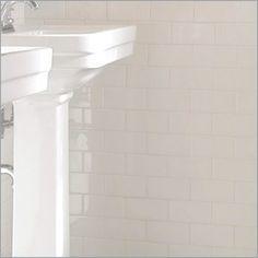 White grout/white tile.  Google Image Result for http://3.bp.blogspot.com/-KL2aHcCvVi8/TZCm_TczdxI/AAAAAAAAAdE/N_vWp4x9hfg/s400/white.subway.jpg
