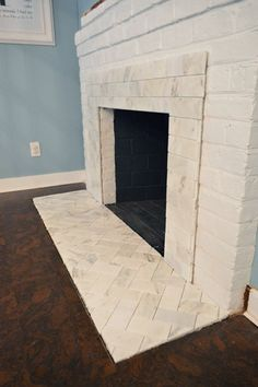 Fireplace Makeover: Sublime Subway | Young House Love love the combo of straight and herring bone pattern