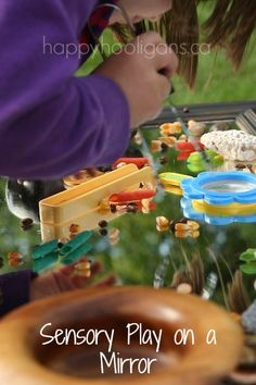 sensory play on a mirror - happy hooligans