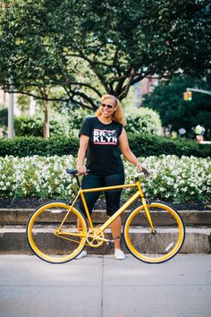 Angie rides a Sole Candy Gold fixed gear bike photographed at Park Ave. and 67th St., Manhattan riding down Park Ave. during Summer Streets