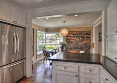 Kitchens - Kathleen DiPaolo Designs Like the archway between the rooms.