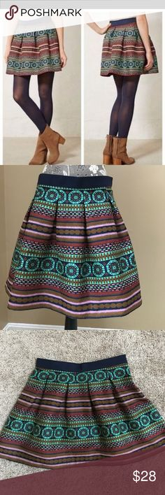 """Anthropologie Nomad Iremel Brocade Skirt Anthropologie Nomad Morgan Carper  Iremel Brocade Skirt size 12. Excellent condition. This adorable swingy skirt makes a statement by itself or pair with some cute jewelry.  89% polyester and 31% cotton, navy blue elastic band, side zipper. 16"""" across the waist and 18"""" long.  Unlined. Anthropologie Skirts"""