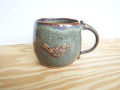 Stoneware Pottery Mug in fog glaze with textured bird.