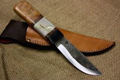 A personal favorite from my Etsy shop https://www.etsy.com/listing/234386131/fixed-blade-hunting-knife-w-figured