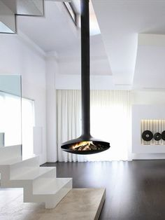 Open Central Hanging Fireplace GYROFOCUS by Focus | #Design Dominique Imbert (1968) #fireplace