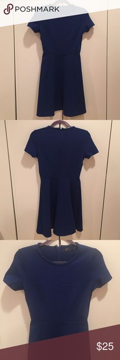 Short Sleeve Blue Fit & Flare Ponte Knit Dress Perfect for work! GAP short sleeve royal blue fit & flare Ponte knit dress. Front darting. Hidden back zipper. Size 2. 58% Cotton / 38% Modal / 4% Spandex/Elastane. Machine washable. GAP Dresses Mini