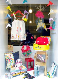 Fresh & sweet kidswear window for consignment or resale shop. Cranes = good luck/ best wishes