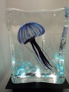 Another gorgeous Murano glass aquarium table lamp, this time, in cool blues, and featuring a floating jellyfish. If you'd like other colours, such as greens, please ask us. To be seen on site soon. In the meantime, please mail us at : sales@italian-lighting-centre.co.uk. These lamps are hugely popular. We're not surprised!