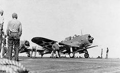 "1 February 1942: an Enterprise Dauntless dive bomber prepares for launch during the Marshall Islands raid.-The bombers pummeled the airfield - destroying an ammunition dump, two hangars, and a radio station - and swung back around to strafe the base and parked planes on the ground. Enemy fighters and anti-aircraft fire claimed three more SBDs, but Enterprise's airmen put on a spirited defense and claimed three ""Claudes"" in exchange."