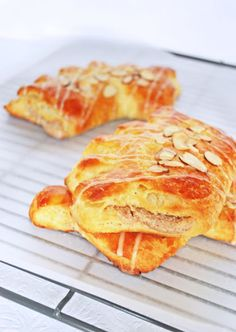 These bear claws are flaky, tender, buttery pastry stuffed with a sweet  almond paste filling, with toasted almond slices and a sweet honey glaze on  top. They smell so good while baking, and you will want to eat these  warm.This is my favorite baked good from Panera, and these homemade ones  are way better.  The pastry is flaky through a process called lamination, in which the  butter becomes layered between the dough.  Roll into a 24 inch x 20 inch rectangle. You'll need flour, the dough…