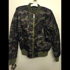 A camouflage jacket New camouflage jacket. It's a size large but it fits like a medium. Fashion nova Jackets & Coats