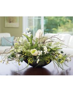 Lilac, Dogwood & TulipSilk Flower Centerpiece The crisp whites and greens of spring blooms bring a burst of permanent freshness into your home or office. White tulips, lilacs, dogwood, w Silk Flower Centerpieces, Easter Flower Arrangements, Silk Floral Arrangements, Easter Flowers, Spring Flowers, Flower Decorations, Spring Blooms, White Centerpiece, Artificial Flower Arrangements