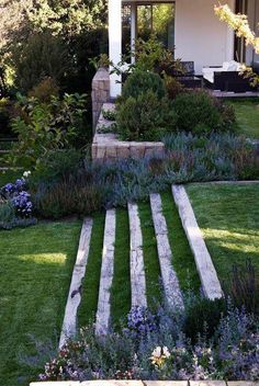 your backyard or front lawn a fresh look this season with these gorgeous garden design ideas.Give your backyard or front lawn a fresh look this season with these gorgeous garden design ideas. Back Gardens, Outdoor Gardens, Garden Stairs, Patio Stairs, Balcony Garden, Exterior Stairs, Sun Garden, Wood Stairs, Garden Beds
