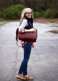 Via Camp Patton - chic outfit with Dansko clogs, skinnies, vest and diaper bag #mommystyle