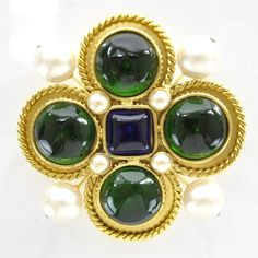 CHANEL Vintage Gripoix Poured Glass and Pearl Brooch in Gold tone.   This elegant brooch has 4 large round green glass cabochons 4 large round pearls 4 small round pearls and 1 squared blueviolet glass center piece.
