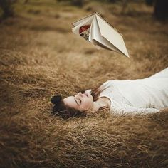 woman girl lying field grass read book magic float levitate white ravenclaw harry potter