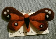 Needle felt burgundy butterfly brooch symbolising awareness or just a pretty accessory for child, sister, nan, mother or friend. Made with merino wool