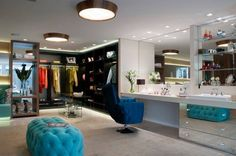 Love Love Love the turquoise tufted ottoman and the vanity with seating IN the walk in closet! Brilliant!