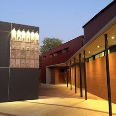 Afrikaans Hoër Seunskool – New Music Centre, Pretoria. New facilities for the music department were required. Classrooms, individual practice rooms, offices and an orchestra & choir room were added between the existing school hall and railway lines. The challenging site led to an intricately connected design with corridors and courtyards. The new architecture makes use of the same building materials as the existing school buildings, but articulated in a contemporary, graphic language