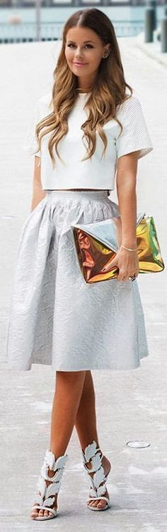 Chic Top with Grey Knee Skirt and Gold Clutch Purse
