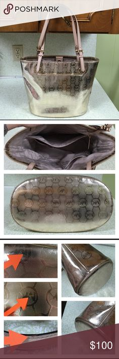 """MICHAEL KORS Gold Mirror Jet Set Grab Bag Tote FINAL PRICE. NO BUNDLE DISCOUNT. Very gently used. All flaws shown. All very Minor. No wear on edges of bag. Edge coat in excellent condition on straps. This bag was only used a few times. Tan leather straps. Oval base on bag. No feet. NO HANGTAG. Very clean inside. 10.5"""" inches tall. 15 inches long at the top. Base is 11.5 inches long and 6.5"""" inches wide. Strap drop 10.5"""" inches. Yes this is authentic. KORS Michael Kors Bags Totes"""
