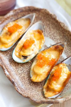 Cheese-mayo mussels or baked mussels dynamite is a simple and delicious appetizer.
