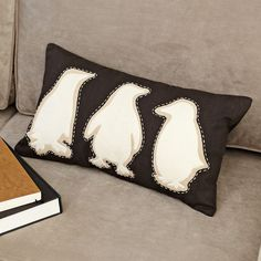 """Penguin Pillow Cover - Think I could DIY this. (What West Elm has to say about it. Huddle up. Featuring three playful penguins stitched on woven cotton, Woven cotton in Espresso; polyfelt applique. 12""""w x 21""""l. Coconut button closure. Dry clean.)"""