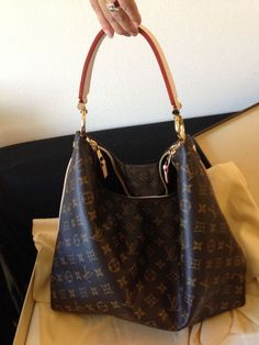 Louis Vuitton Sully MM. LOVE this stunning bag, cannot stand the piping down the side. :(