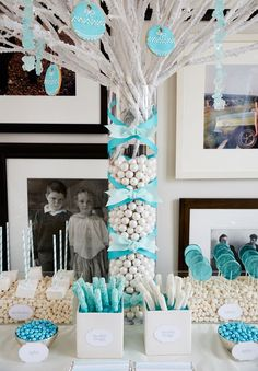 Winter wonderland party - white tree branches with cookies hanging on them